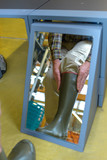 customer trying rubber boots in the shop - 181618502