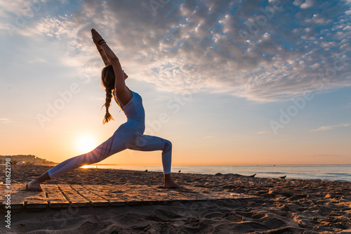 Fotobehang School de yoga girl doing sport on the beach