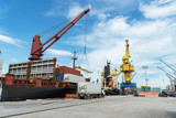 harbor crane lifting a sea container into a cargo ship,container,container ship in import export and business logistic.By crane , Trade Port , Shipping.Tugboat assisting cargo to harbor.. - 181624732