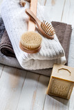 solid soap, body brush, hairbrush and towels for green bath - 181627318