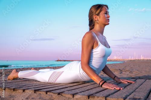 Naklejka girl doing sport on the beach