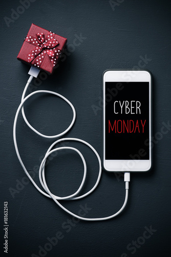 gift and text happy cyber monday in a smartphone
