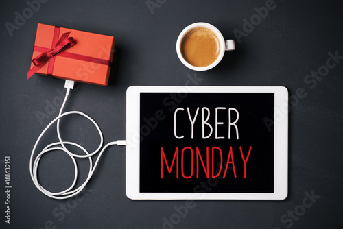 gift and text happy cyber monday in a tablet