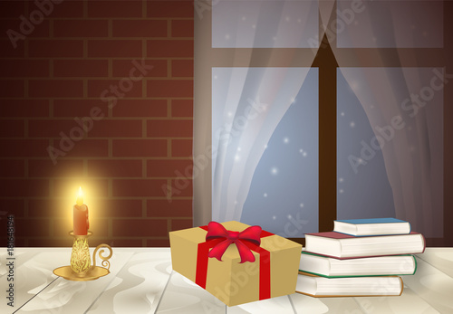 Candelabra with pile of book and gift box on the table in winter season background