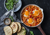 Coconut milk curry vegetables shakshuka and grilled bread on dark background, top view. Tasty comfort food - 181649950