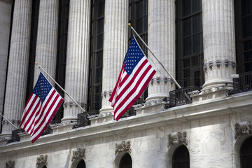 Flags wave outside the New York Stock Exchange, New York, USA