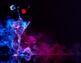 martini cocktail splashing in blue and purple smoky background - 181657966