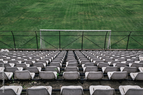 Small stadium, a row of chairs Poster