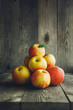 Apples on wooden background - 181683386