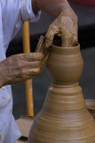 Potter Shaping a Clay Pot - 181689322