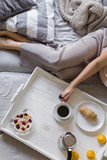 Morning moments in bed- A woman is having breakfast and drinking coffee in bed - 181691920