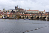 View on the autumn Prague gothic Castle with the Charles Bridge, Czech Republic