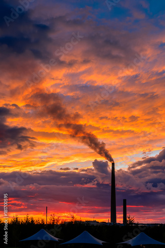 Poster Canada View of a smelter stack of a nickel plant showing the emission on the air with sunset sky as as background