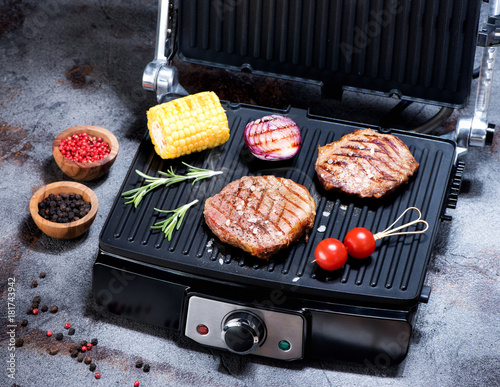 Plexiglas Steakhouse Beef steak with vegetables. Preparation on electric grill