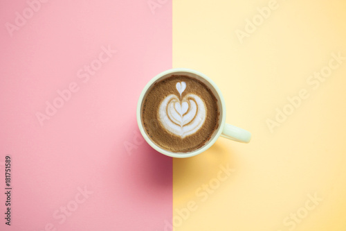 Poster coffee cup with cappuccino on pastel background  top view