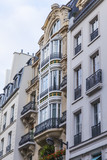 PARIS, FRANCE, on October 27, 2017. The sun lights the city street and typical architectural details of houses of in downtown. Building facade fragment,