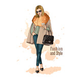 Fashion vector illustration. Hand drawn sketch. Stylish woman in fashion clothes with bag and cup of coffee. Dressed in trousers and coats. - 181753561