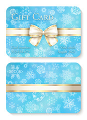 Luxury baby blue Christmas gift card with white snowflakes in background and cream ribbon as decoration