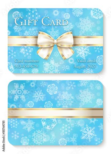 Zdjęcia na płótnie, fototapety, obrazy : Luxury baby blue Christmas gift card with white snowflakes in background and cream ribbon as decoration