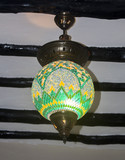Oriental green yellow glass Moroccan lantern. Stylish fashion interior design for spa salon, relax and meditation studio. Vintage style.