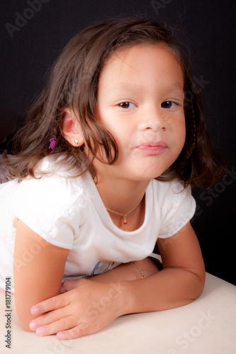 A beautiful young mixed child girl posing