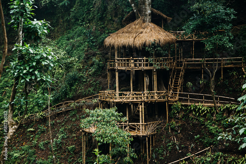 Wooden bamboo hovel house in forest. Film color toned filter