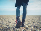Legs of a woman walking on the beach in autumn - 181799553