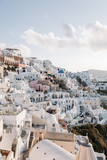 View of famous white buildings of Oia town on cliff in Santorini, Greece - 181799574
