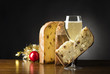 Christmas cake  and glass with champagne on the wooden table