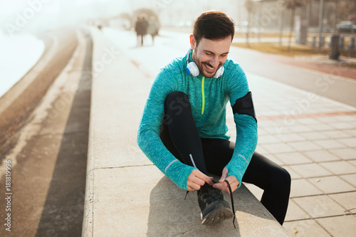 Tuinposter Jogging Handsome sportsman training jogging and exercising outdoor