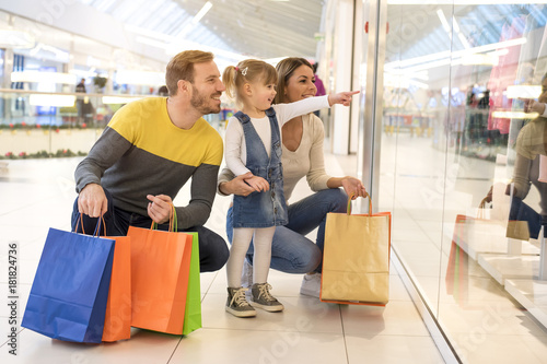 Happy family with child and shopping bags doing shopping