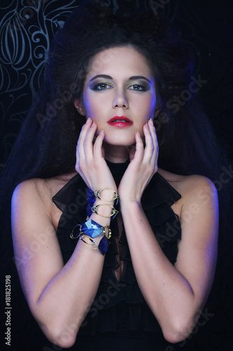 Young brunette woman with high hair and bright make up, gothic Poster