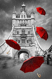 Tower Bridge on River Thames with flying umbrellas. London, England. Black and white concept graphic with red element. - 181833794