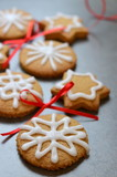Festive cookies on stone background with red bows - 181841116