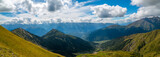 Amazing panoramic view to Caucasus Mountains.  Densely dark coniferous forests and high mountain peaks. Sunny day with blue mountains. Svaneti, Geogria.