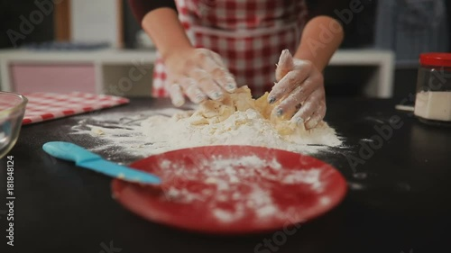 Sticker Woman rolling dough for pie on kitchen table
