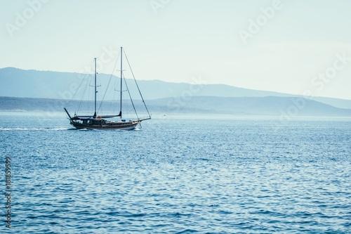 Plexiglas Zeilen Sailboat on blue sea background