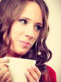 Autumn woman holds mug with coffee warm beverage - 181863552