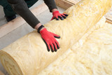 worker insulates the floor with mineral wool - 181871357