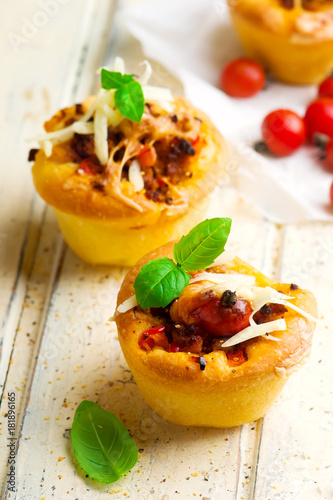 pizza muffins bolognese sauce. selective focus Poster