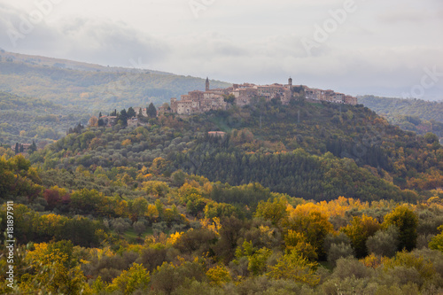 Staande foto Toscane The traditional medieval town on the hills of Tuscany in the haze, Italy