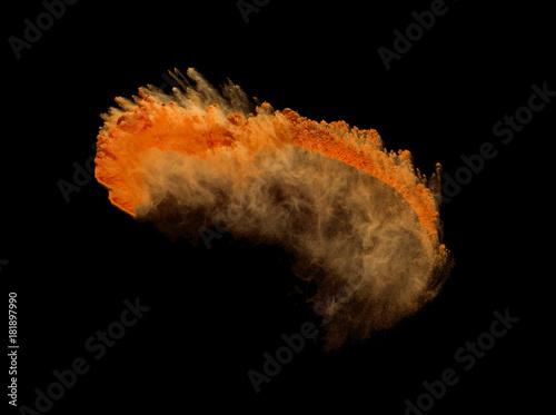 Leinwandbild Motiv Orange powder splash isolated on black background