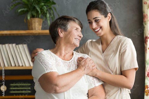 Senior woman and younger friend Poster