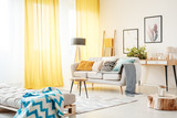 Living room with yellow curtains