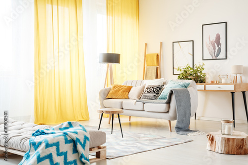 Foto Murales Living room with yellow curtains