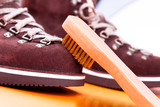 Brown man suede boots with brush. Macro. Clean shoes - 181902345