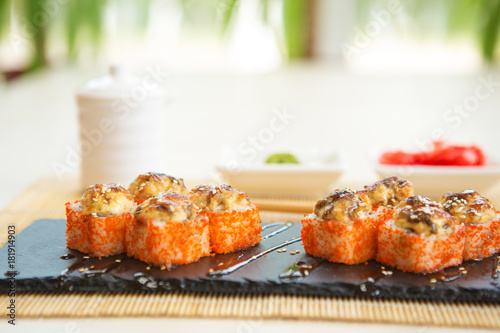 Staande foto Sushi bar Sushi roll sushi with fish, cream cheese and vegetables. Sushi menu. Japanese food