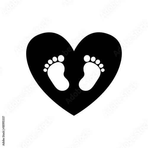 Baby footprints inside of black heart icon isolated on white background.