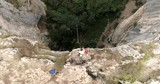Bungee jump in a cave. Aerial view, 4k superwide - 181921717
