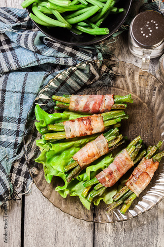 Fried green bean wrapped in smoked bacon